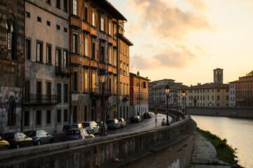 Fototapeta Charming Street in Pisa Italy on sunset