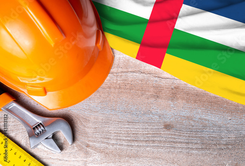 Central African Republic flag with different construction tools on wood background, with copy space for text. Happy Labor day concept.