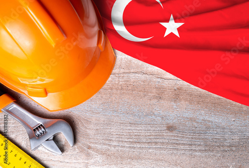 Turkey flag with different construction tools on wood background, with copy space for text. Happy Labor day concept.