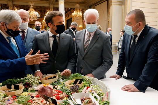 French President Macron attends a traditional ceremony for May Day in Paris