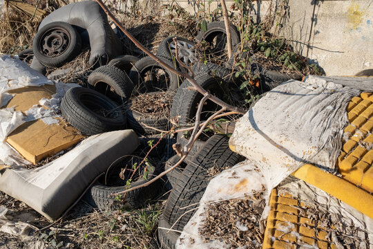 Waste illegally disposed of in nature and old used car tires