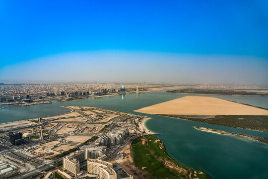Abu Dhabi, United Arab Emirates, March 2021, Aerial view around Yas Island and Al Raha creek with Al Sail Tower building and Aldar headquarter building in the background