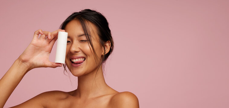 Asian female model showing a skin product