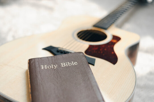 Christians worship God with a guitar with the Holy Bible. reading the Bible and sharing the gospel with copy space for the word of god.