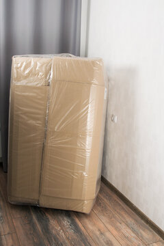 large cardboard parcel delivered to the customer in the apartment