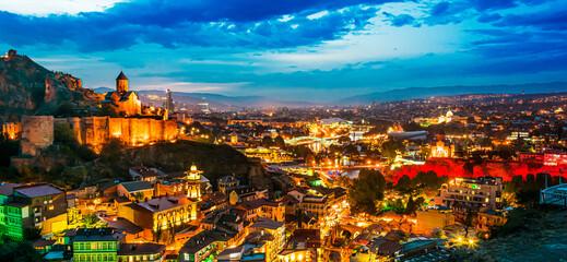 Fototapeta Panoramic view of Tbilisi, Georgia after sunset