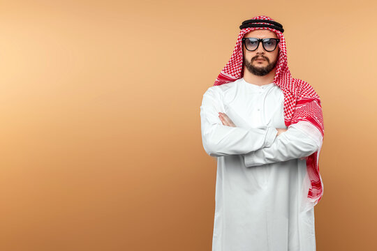 A Saudi Arab man in national dress and sunglasses. Dishdasha, kandora, thobe, islam. Copy space.