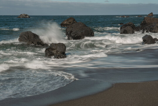 Portuguese Beach by Highway 1, showing waves hitting rocks, long exposure
