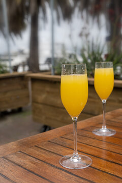 Two glasses of Mimosa outdoor sitting restaurant, nobody in it