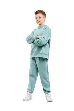 boy in turquoise blue tracksuit isolated on white background.
