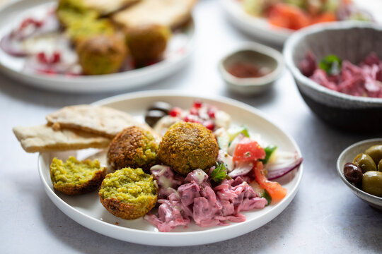 Middle eastern spread with falafel, olives and beetroot salad