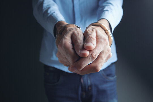 men handcuffed in criminal concept