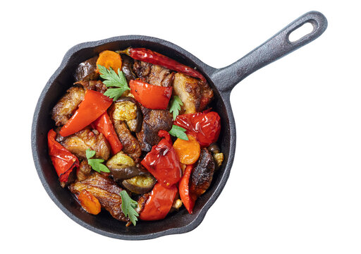 Pork with grilled vegetable stir fry on pan isolated on white, top vew
