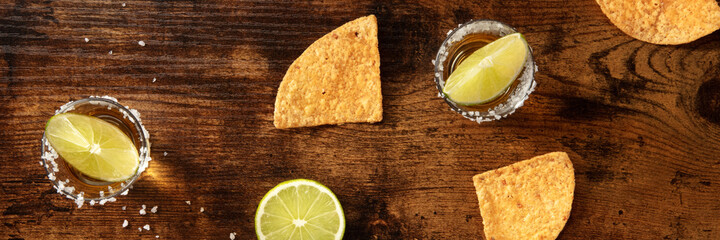 Tequila and nachos panorama, a flat lay