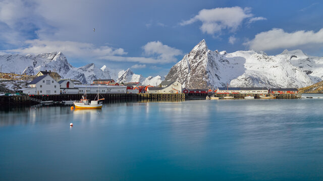 Winter landscape with snow covered mountains and the little fishing village of Hamnoy on the Lofoten islands in northern Norway