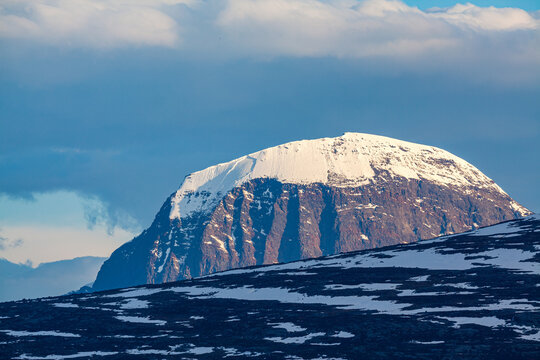 The characteristic snow covered flat top of the mountain Niak in Sarek National Park, Lapland, Sweden