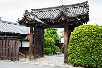 Fushimi Inari Taisha Shrine in Kyoto, Japan with beautiful red gate and japanese garden. Red Torii gates in Fushimi Inari shrine in Kyoto, Japan.