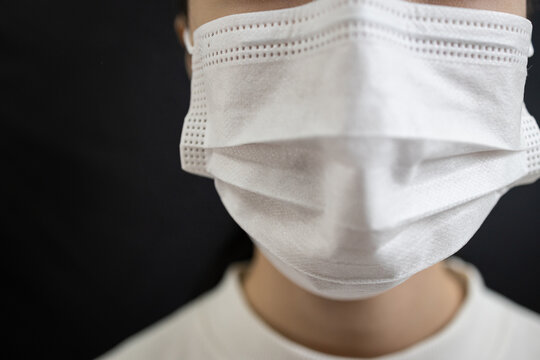 Asian woman wearing face mask,disease prevention campaign,wearing protective face masks before leaving home,in the city street,public,community,prevent contagious or spreading Coronavirus COVID-19