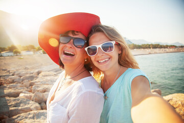 Happy people, Mother And Adult Daughter Making Selfe On The Beach Traveling Together
