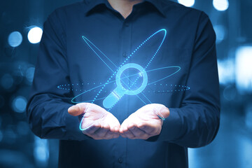 Global search concept with digital magnifying glass symbol between man open palms.