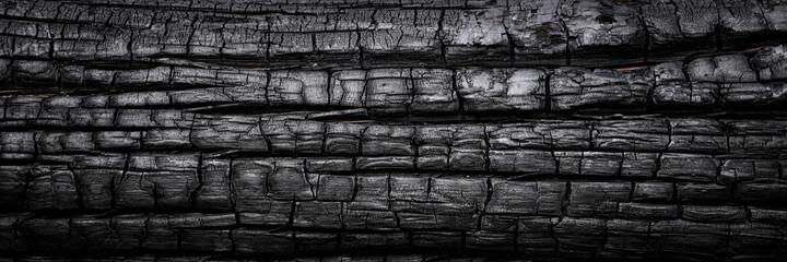 Dark texture of firewood charcoal