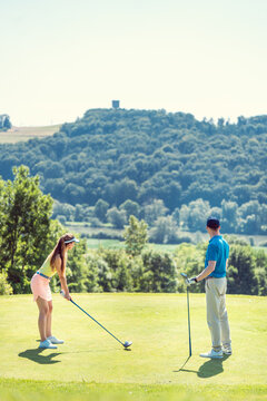 Couple playing golf on a summer day