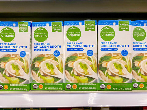 Louisville, Ky USA- May 3, 2021: Cartons of Kroger brand Simple Truth Organic free range low sodium chicken broth on a grocery shelf