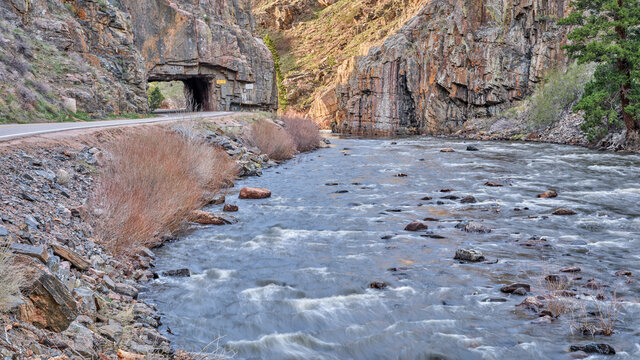 highway tunnel in the mountain river canyon - Cache la Poudre River at Little Narrows above Fort Collins in northern Colorado, early spring scenery