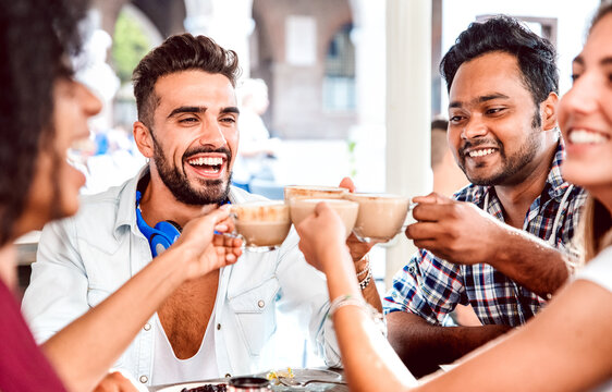 People group drinking latte at coffee bar restaurant - Happy friends talking and having fun together at cafeteria dehors - Life style concept with happy men and women at cafe - Focus on left guy