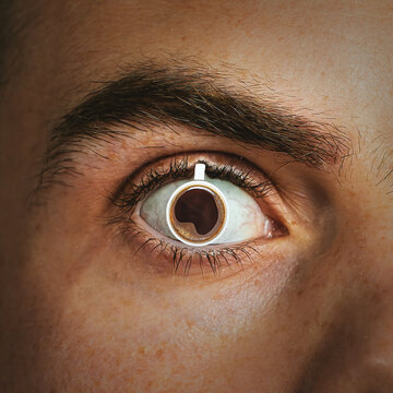 A mug of hot coffee is inserted into the man's pupil. Concept of caffeine effect, addiction
