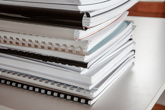 Stack of binded workbooks on a table