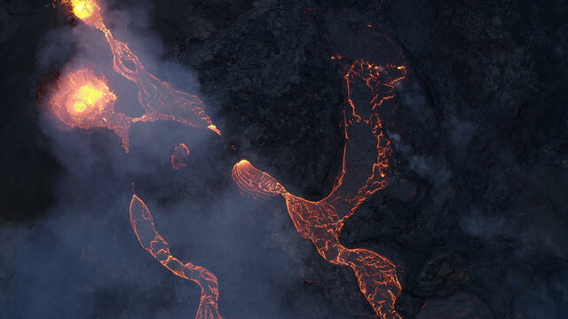 lava eruption volcano with snowy mountains, Aerial view Hot lava and magma coming out of the crater, April 2021