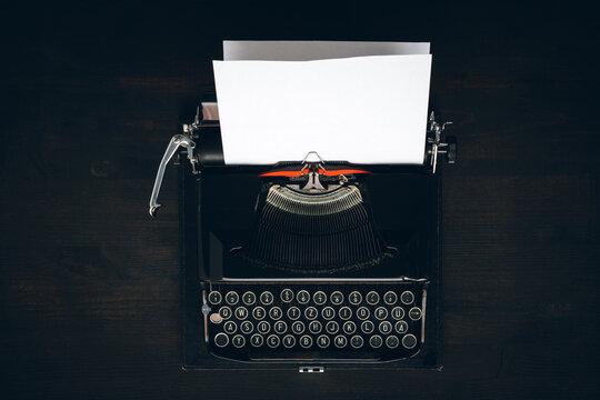 Vintage typewriter with blank paper mock up