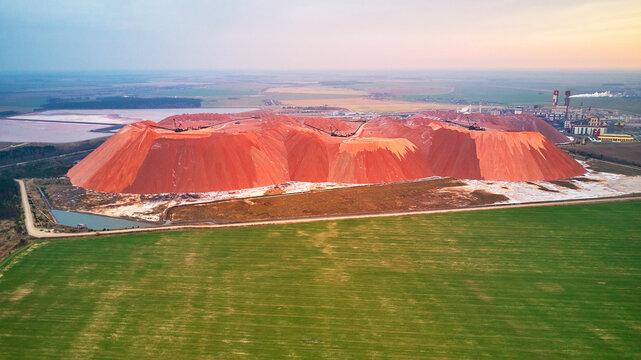Extracting mining potassium, magnesium salts minerals. Large excavator machine, mountains of waste ore. Belarus, Soligorsk