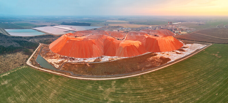Fertilizer industrial plant. Artificial hills of dumps in production of potash. Ecology problem panoramic aerial view. Extracting mining potassium, mountains of waste ore