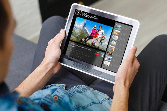 Man watching videos online on tablet