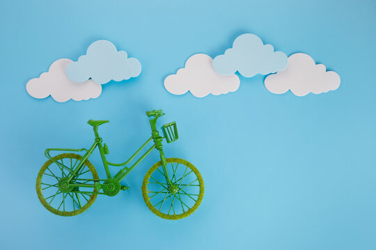 3rd June World Bicycle Day. Green bicycle on blue background. Environment preserve.