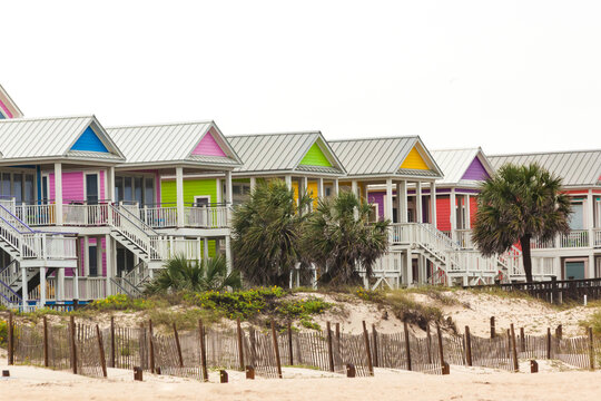 Bright, multi-colored, two-story houses on a beach in Florida.