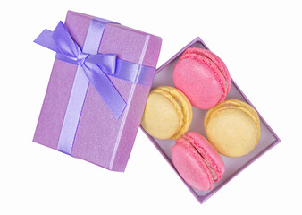 Wall Murals Sweet Monsters Purple box with different tasty macarons isolated on white background. Top view