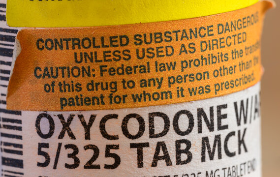 Oxycodone is the generic name for opoid pain killing tablets. Prescription bottle for pills and tablets with focus on the medication.