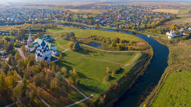Aerial view of the Kremlin and Kamenka river on sunny autumn day. Suzdal town, Vladimir Oblast, Russia..
