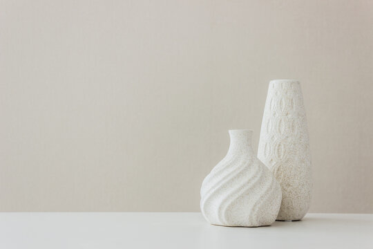 A white vase on the table