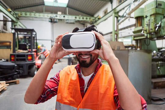 Workers with VR glasses simulating the factory of the future