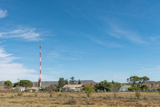 Farm buildings and a cell phone tower near Hanover