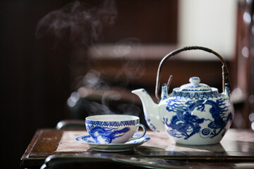 Old style Chinese tea mugs, Chinese hot tea set on an old Chinese wooden table.