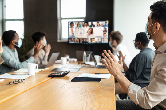 Diverse businesspeople making online video call to employees