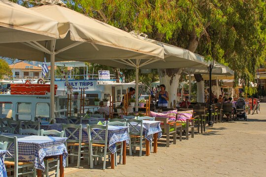 Vasiliki, Greece - July 24 2019: Architecture of Vasiliki, restaurants, oldschool cars, markets with people walking by
