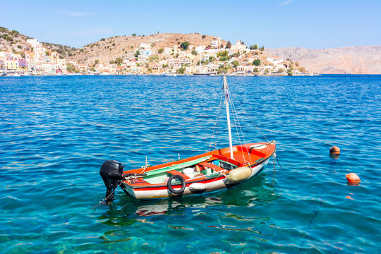 Boat in Symi town harbor, Dodecanese islands, Greece