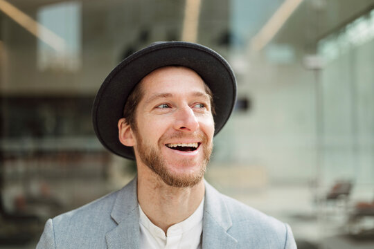 Smiling male professional wearing hat looking hat