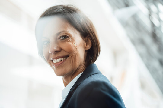 Smiling mature businesswoman at office
